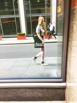 Mandula Pap in London street - reflected in window.