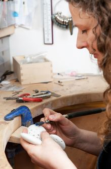 Sarah King in the jewellery studio, working.