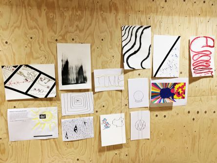 Ekaterina Vdovichenko's 100 Design Projects work pinned to wall.