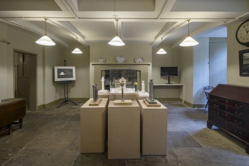 exhibition with sculptures presented on a series of plinths