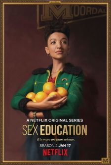 A promotional portrait of Maeve from the Netflix series, Sex Education, with an armful of oranges.