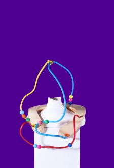 multicoloured wiring artefact attached to a neckbrace on top of a mannequin