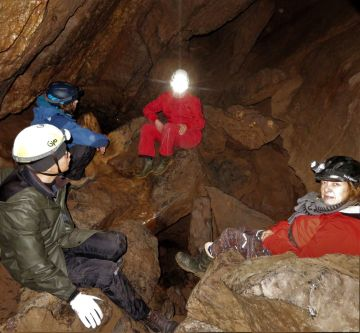 A group of students in a cave