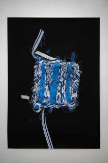 Textile knitted sample hung in a gallery space