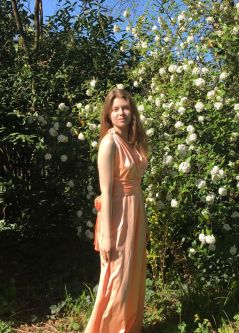 Sophie de grappling wearing a pink dress