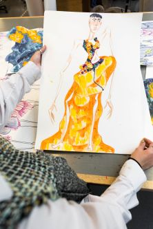 A colorful fashion illustration of a yellow dress