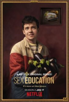A promotional portrait of Otis from the Netflix series, Sex Education, with an armful of aubergines.