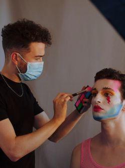 Craig putting makeup on a model