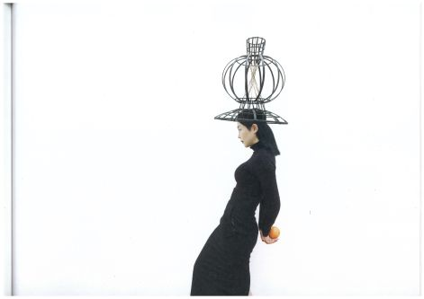 Model with metal framed hat on head