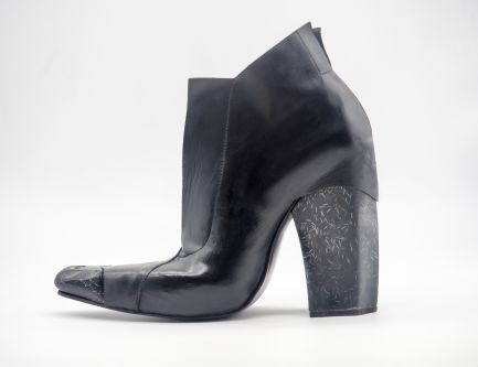 Black leather heeled boots with pointed toe