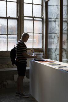 Male visitor looking at student work