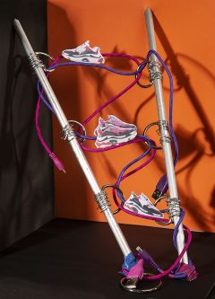 Work by Visual Merchandising - Interiors students, taken by Sarah Manning. Photographs of pairs of trainers perched on USB wires coiled around two metal spikes.