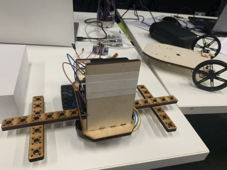 robot being programmed with laptop