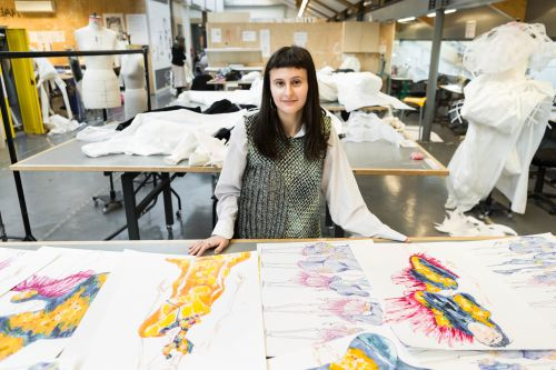 Emily with her colourful fashion illustration portfolio