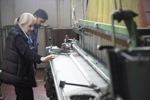 Ranura in the knitting factory looking at a large Jacquard weaving machine