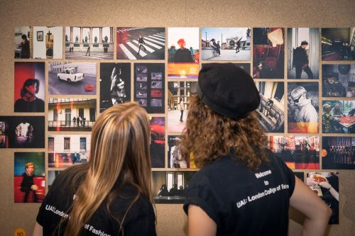 Visitors looking at student work