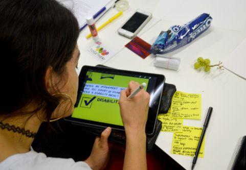 lady drawing on an ipad