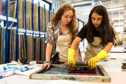 Two Summer Study Abroad students working together on a textile design project