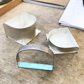 Shaped silver sections, ready to be assembled.