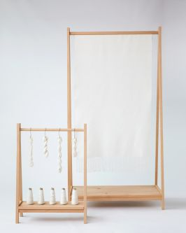Fabric and thread hanging from wooden frames