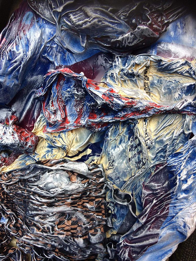A close-up of Plastico's cape, made of old plastic bags and containers, and EVA foam covered with thermoplastic and paint