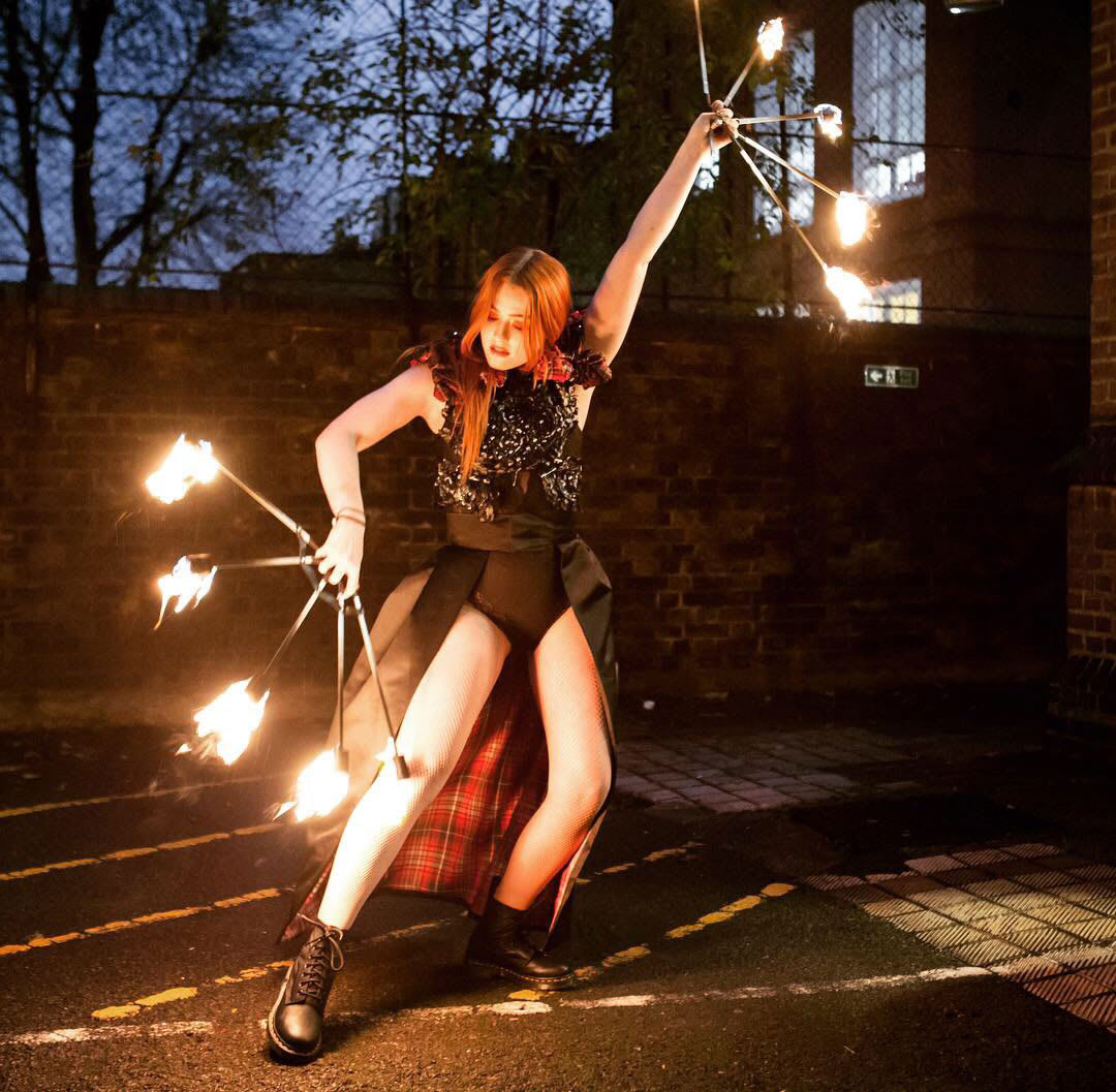 Fire dancing and hula hoops with costume and styling