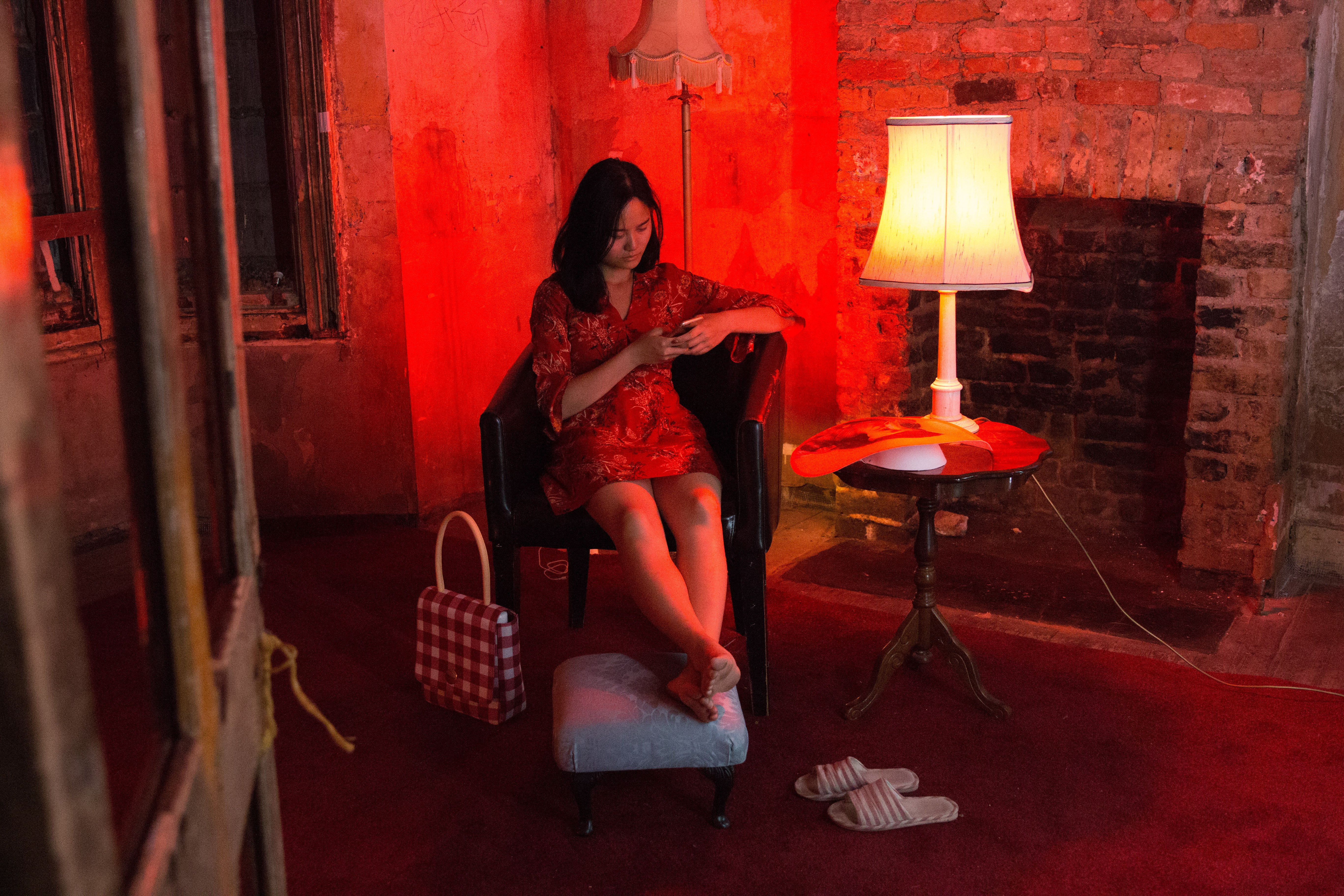 women sat in armchair with red light crafting
