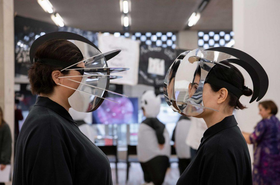 Two people wearing masks