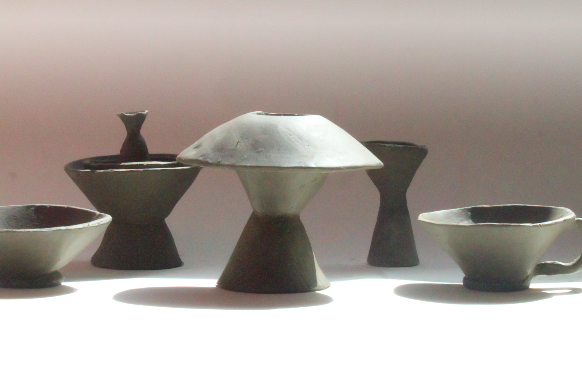 photograph of conical clay vases, jugs and vessels in different sizes or forms