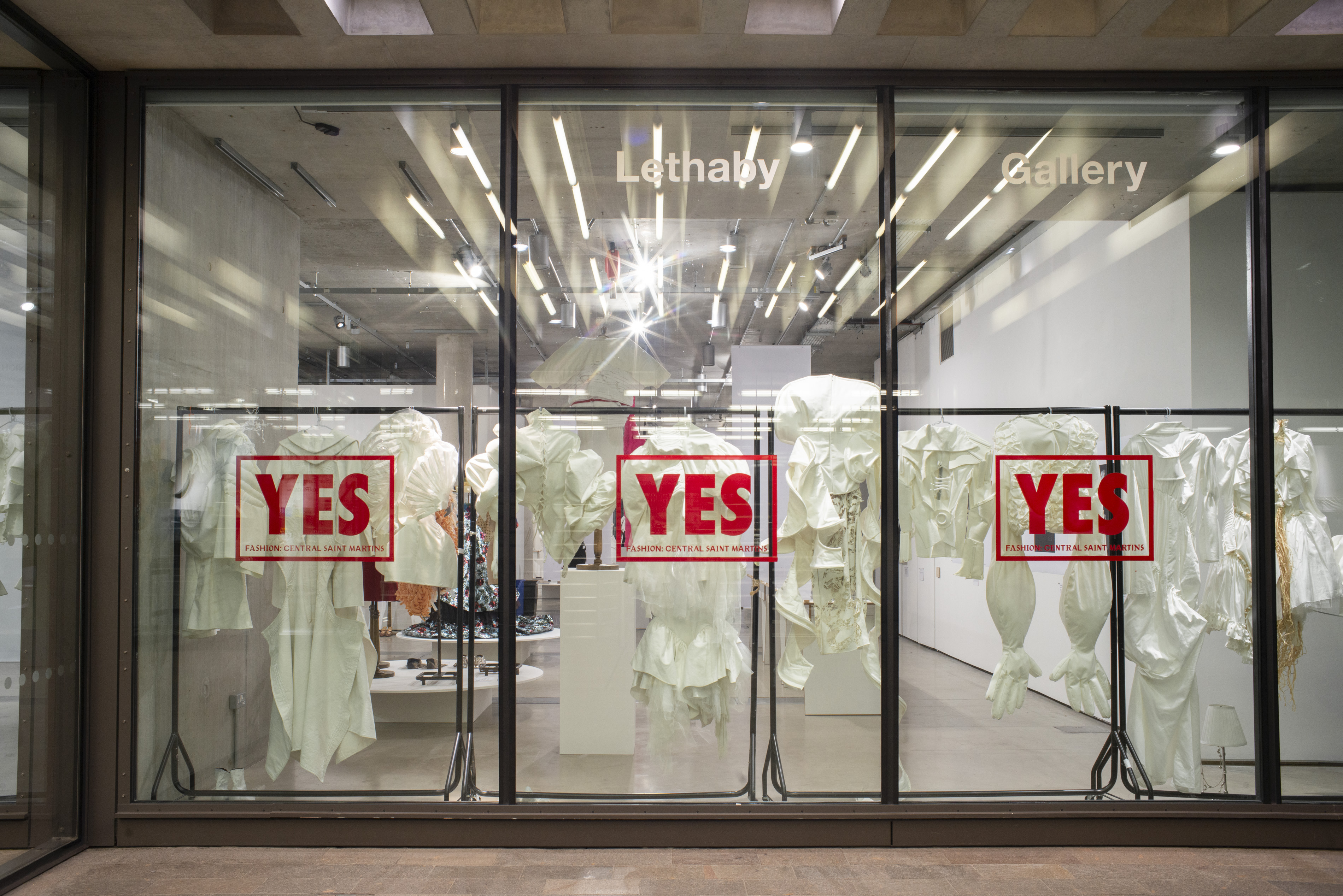 Exhibition window with YES stamped across