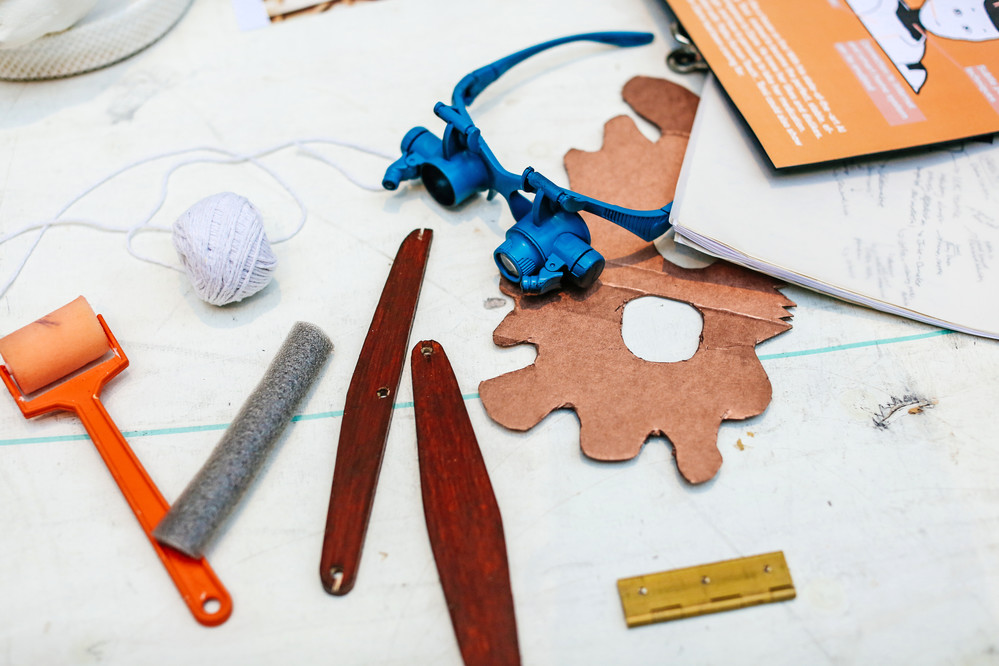 Tools and materials laid out on table
