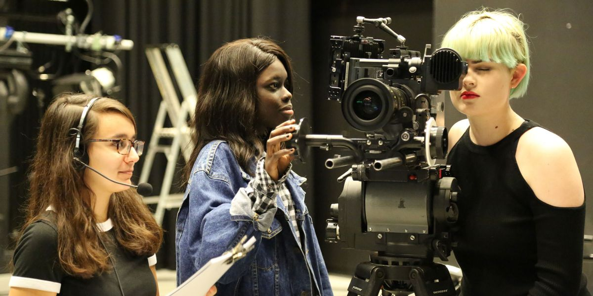 Three women project manage a film-shoot.