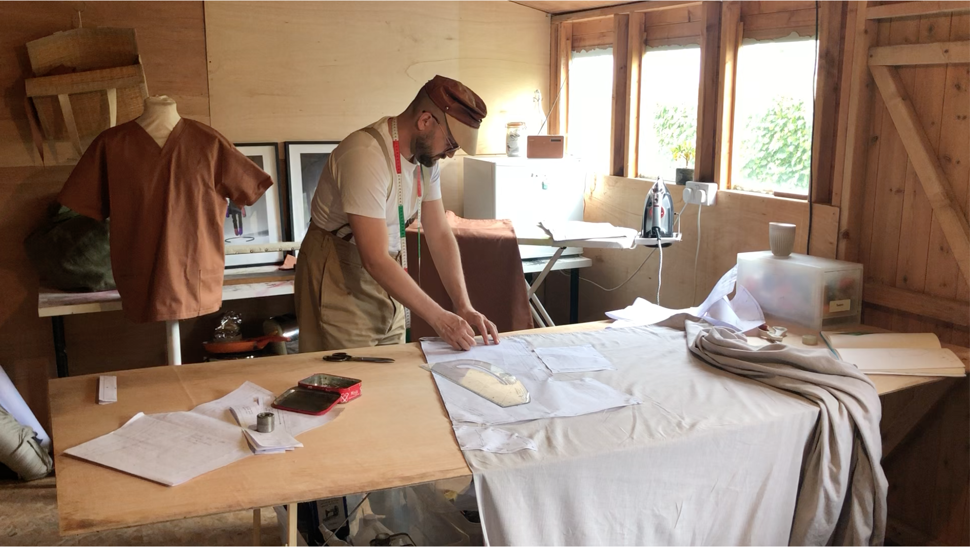 Man in studio creating garments