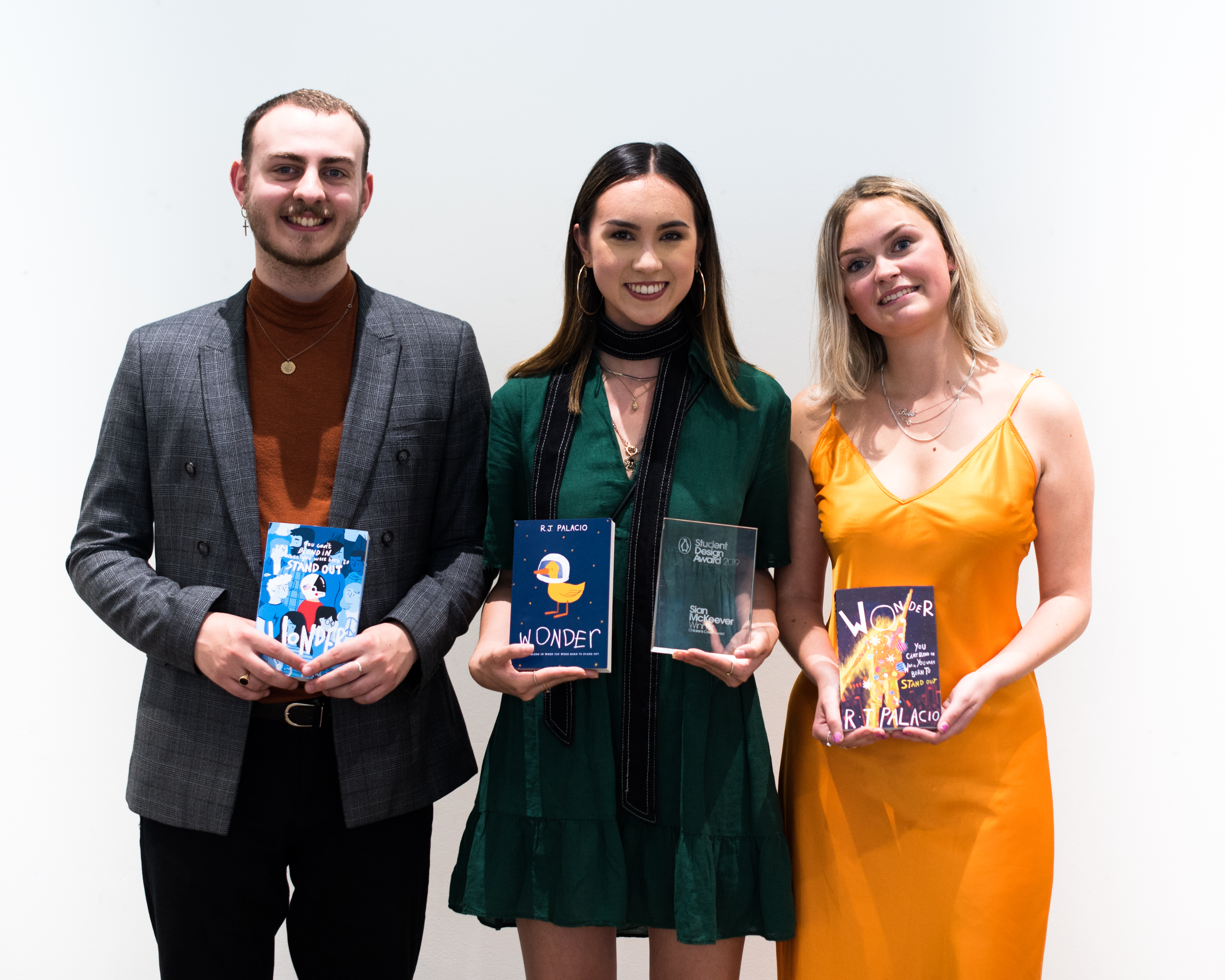 Illustration student Sian McKeever stands with fellow award winners after winning for student design award for Penguin Random House