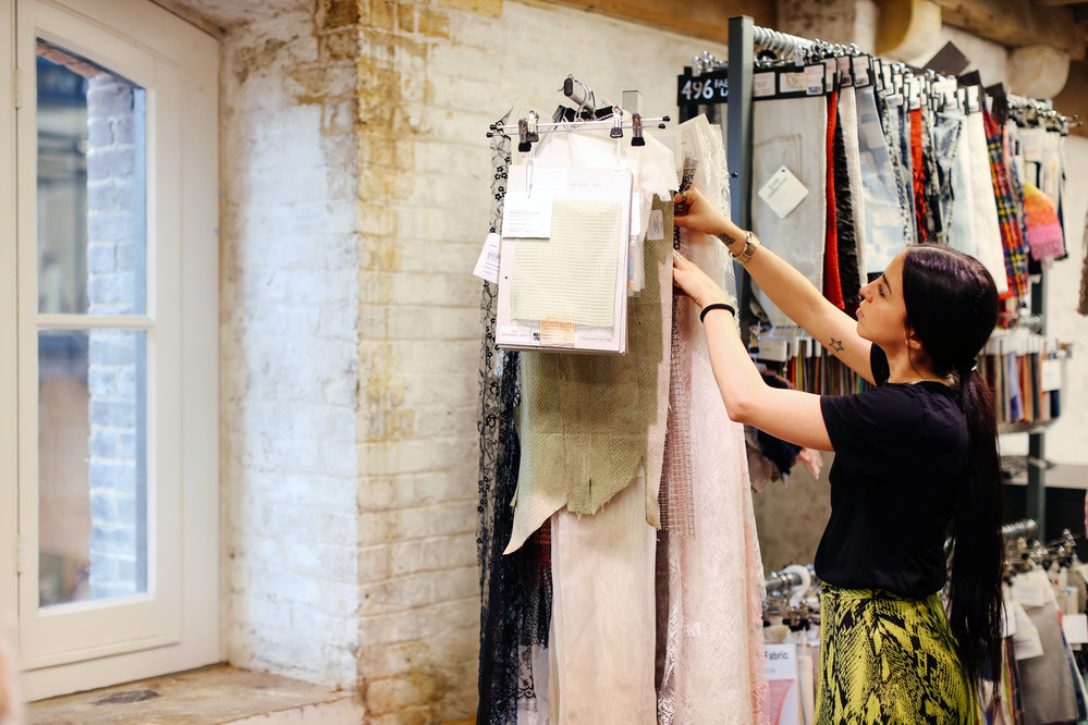 Student looking at fashion textiles