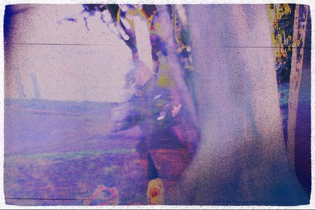 Overexposed purple image of man in woods