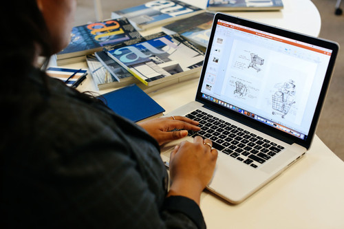 Image of a person using a laptop