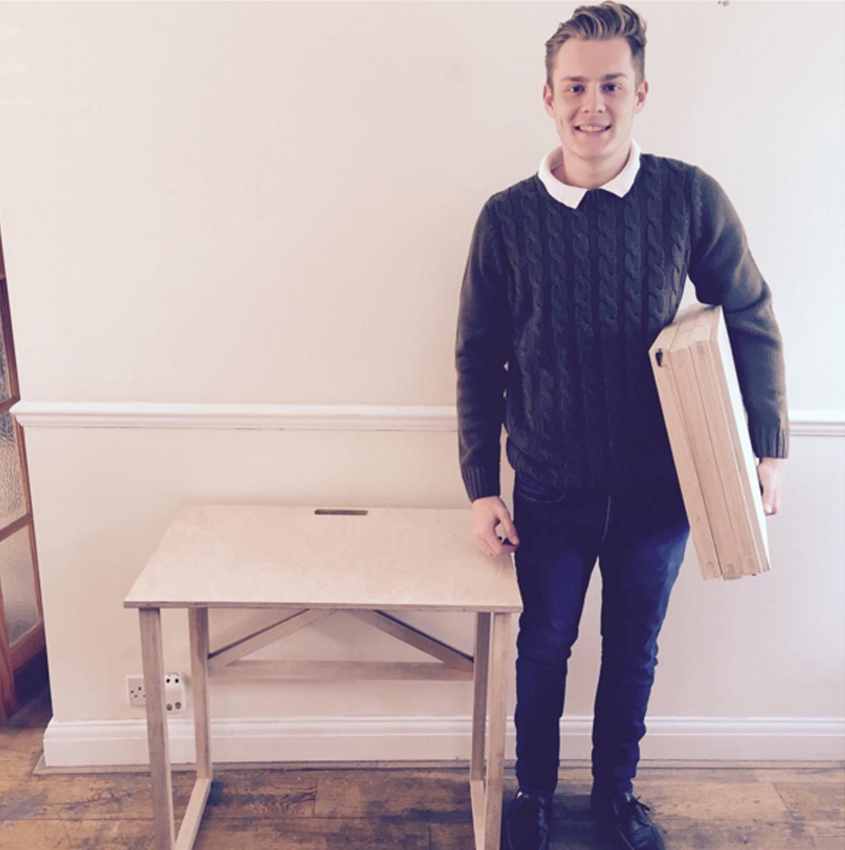 Ben Perkins pictured with his space saving furniture collection, 'Perki Furniture'