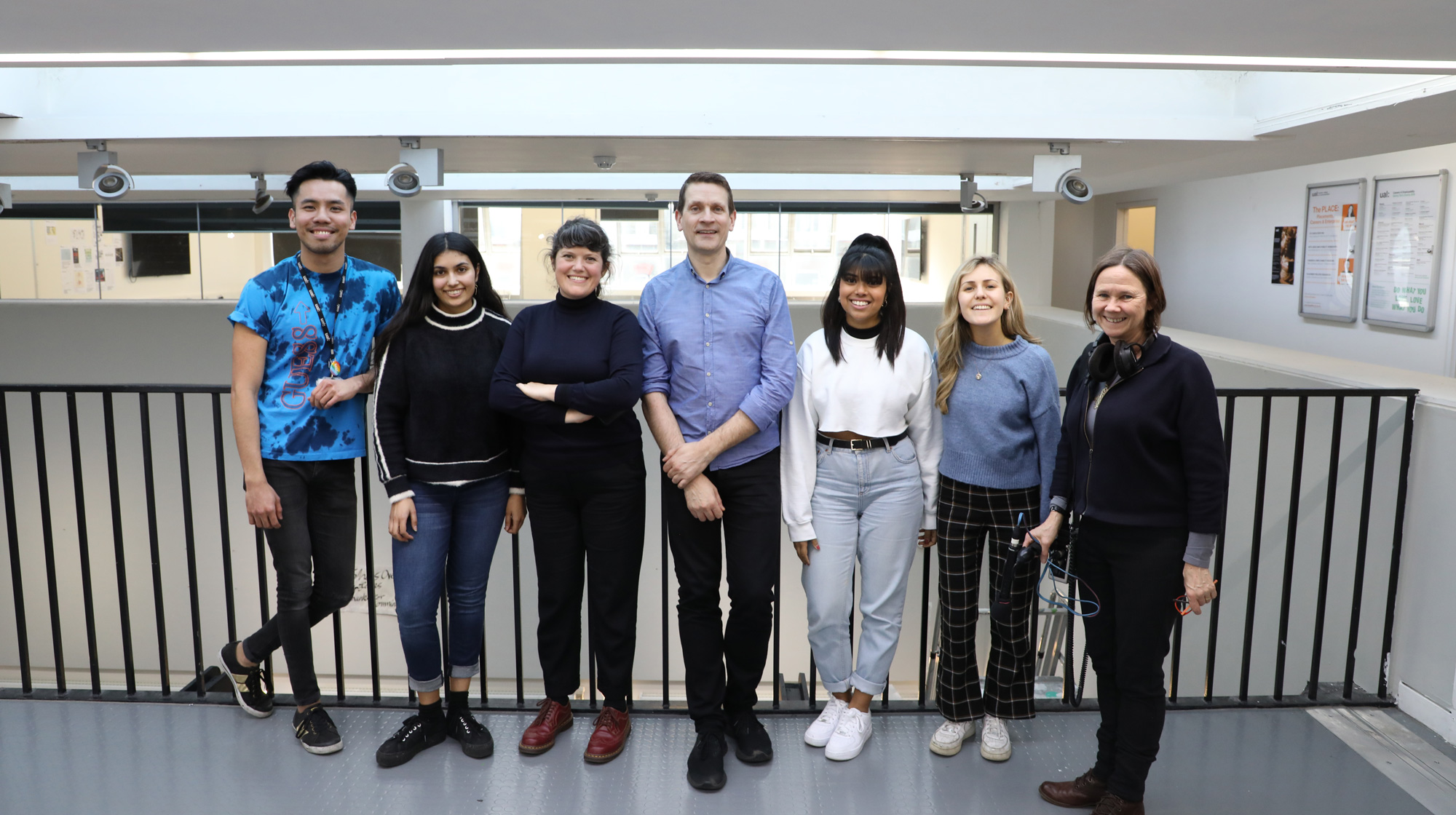 Posed group photo of Bruce Daisley with BBC producer and LCC students smiling at camera
