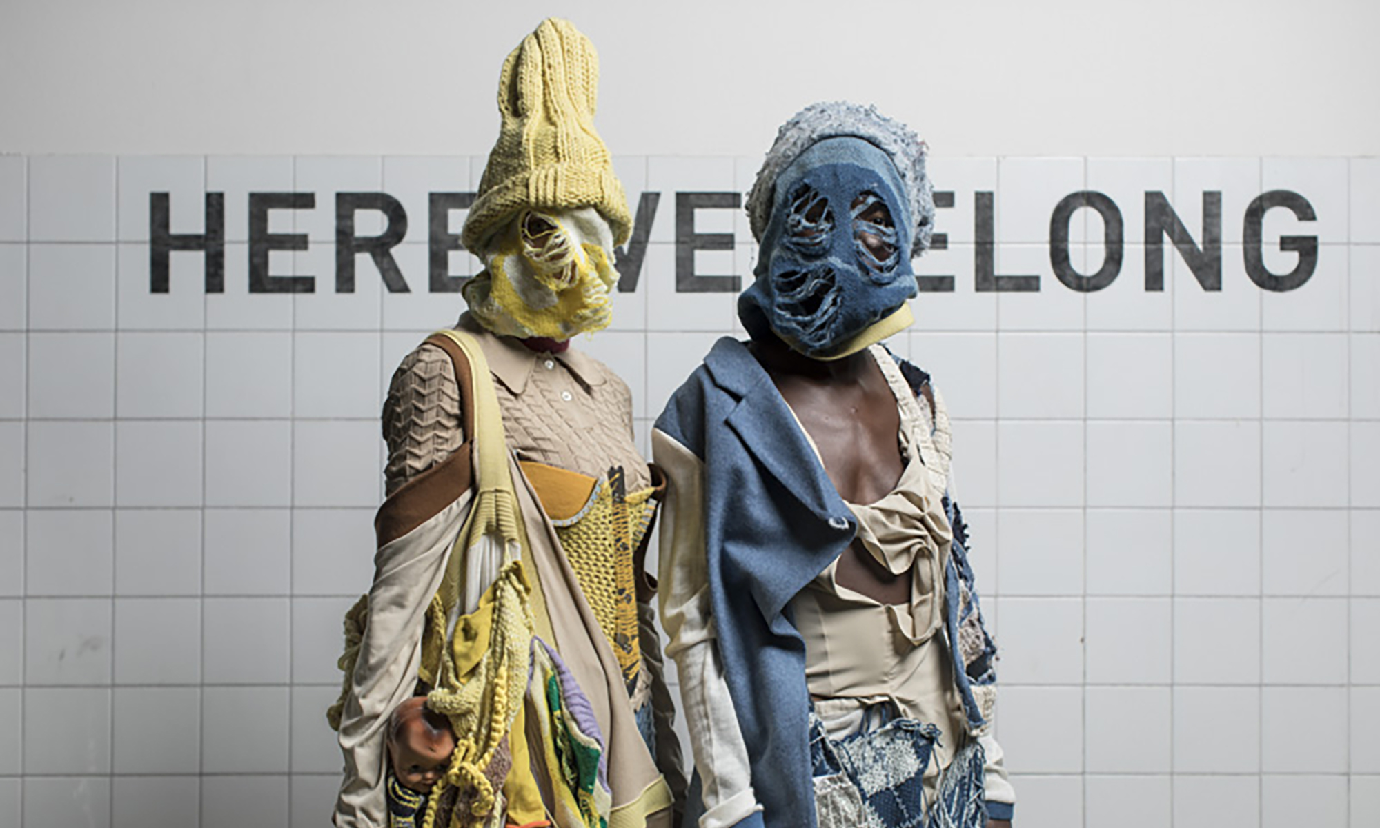Model wearing sustainable knitwear covering face