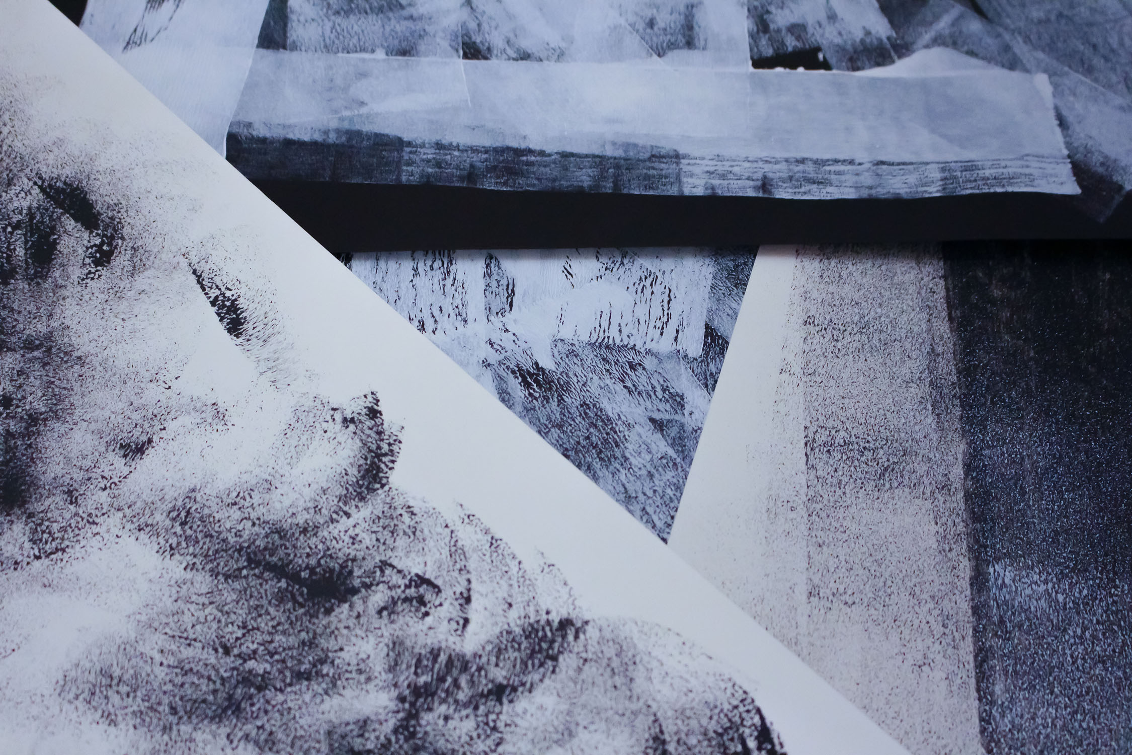 Multiple sheets of paper showing rubbings from different objects to create a texture