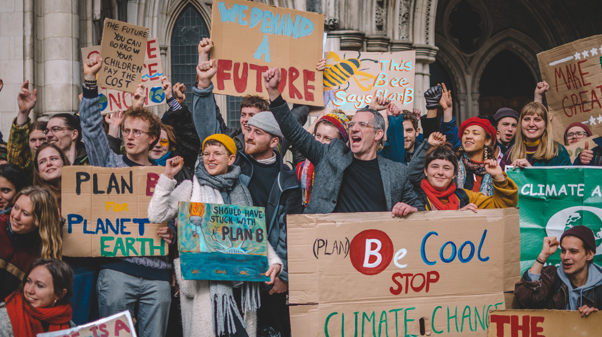 Photo of group of climate protestors holding banners, including 'We demand a future'