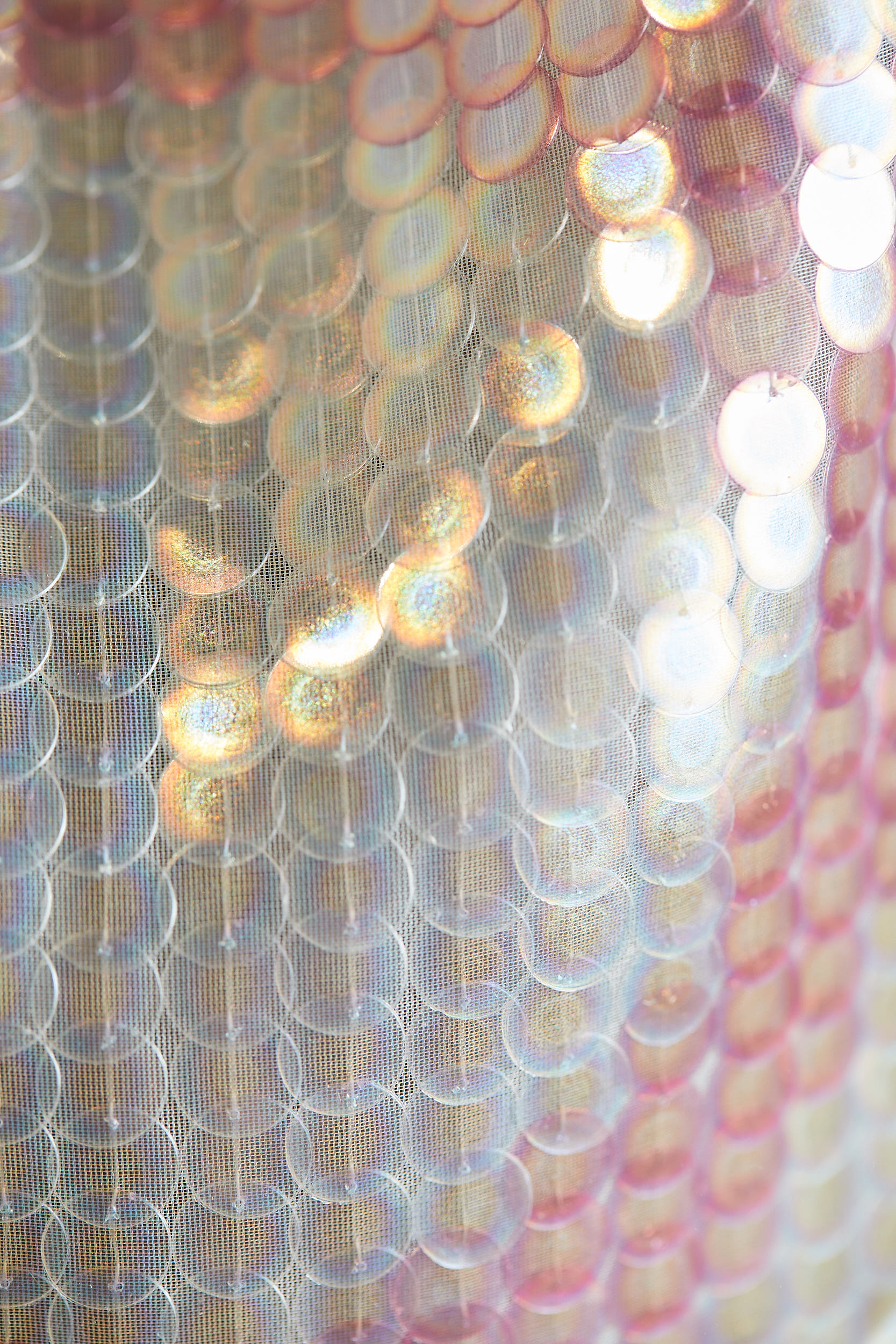 Sequins embroidered onto hanging textile