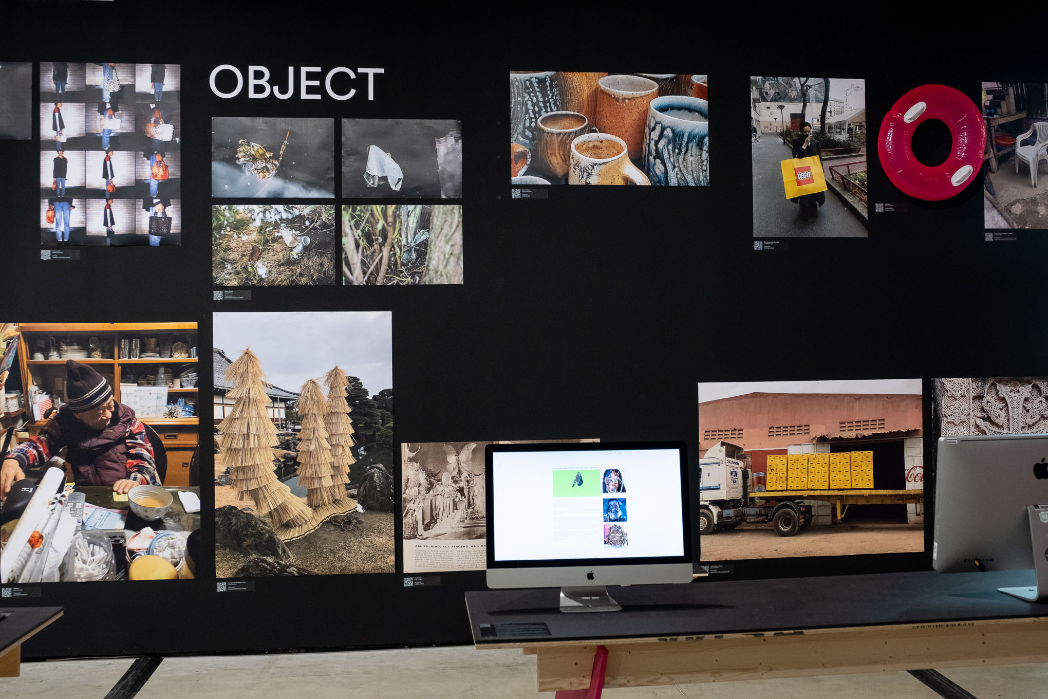 Black wall covered with images and title 'objects'