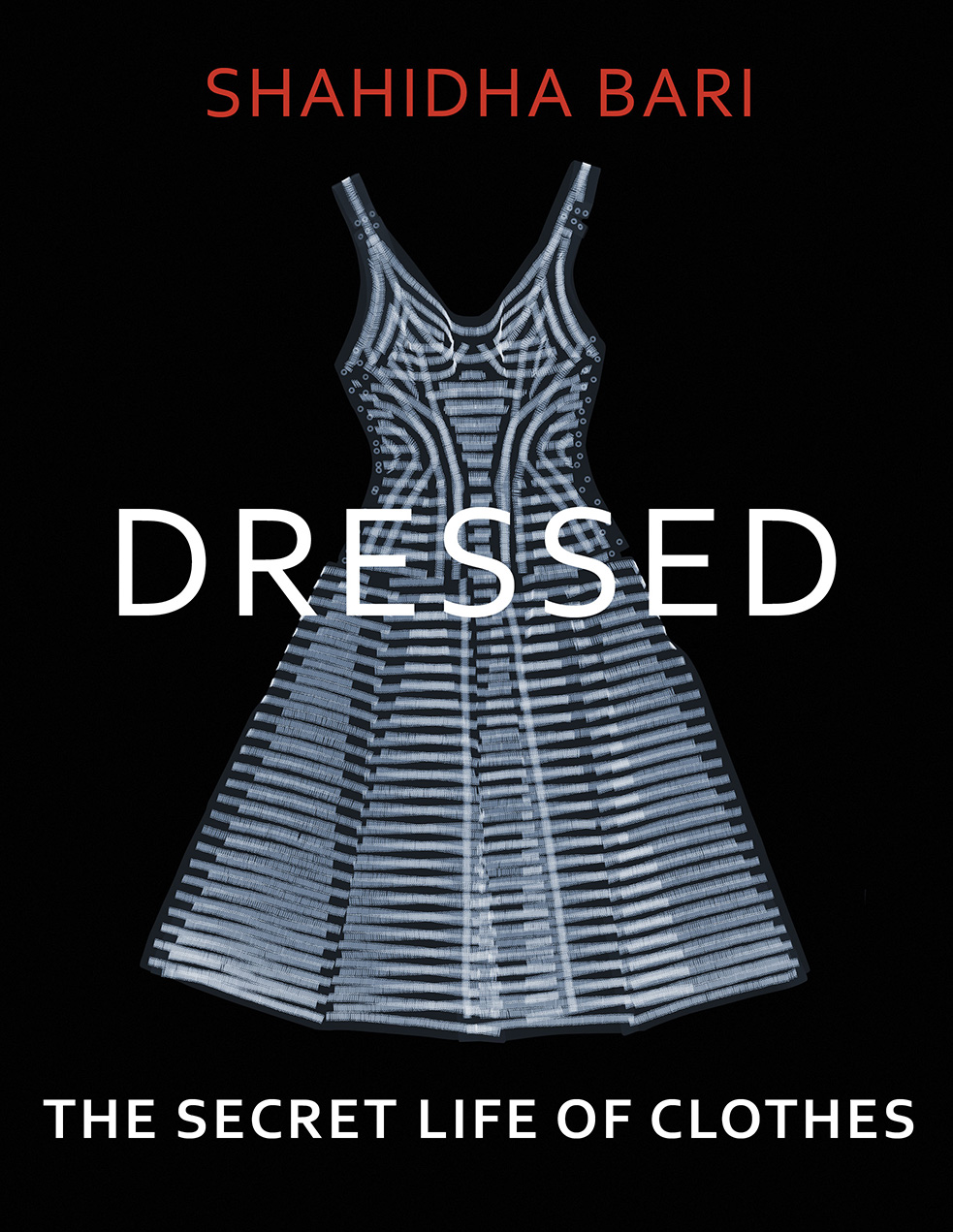 Book cover with black background and x-ray image of a-line dress