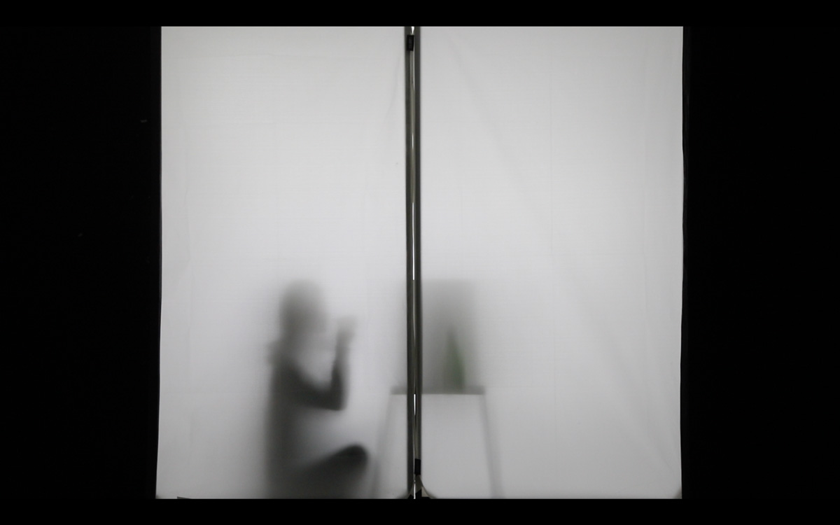 Silhouette of person sat at desk.