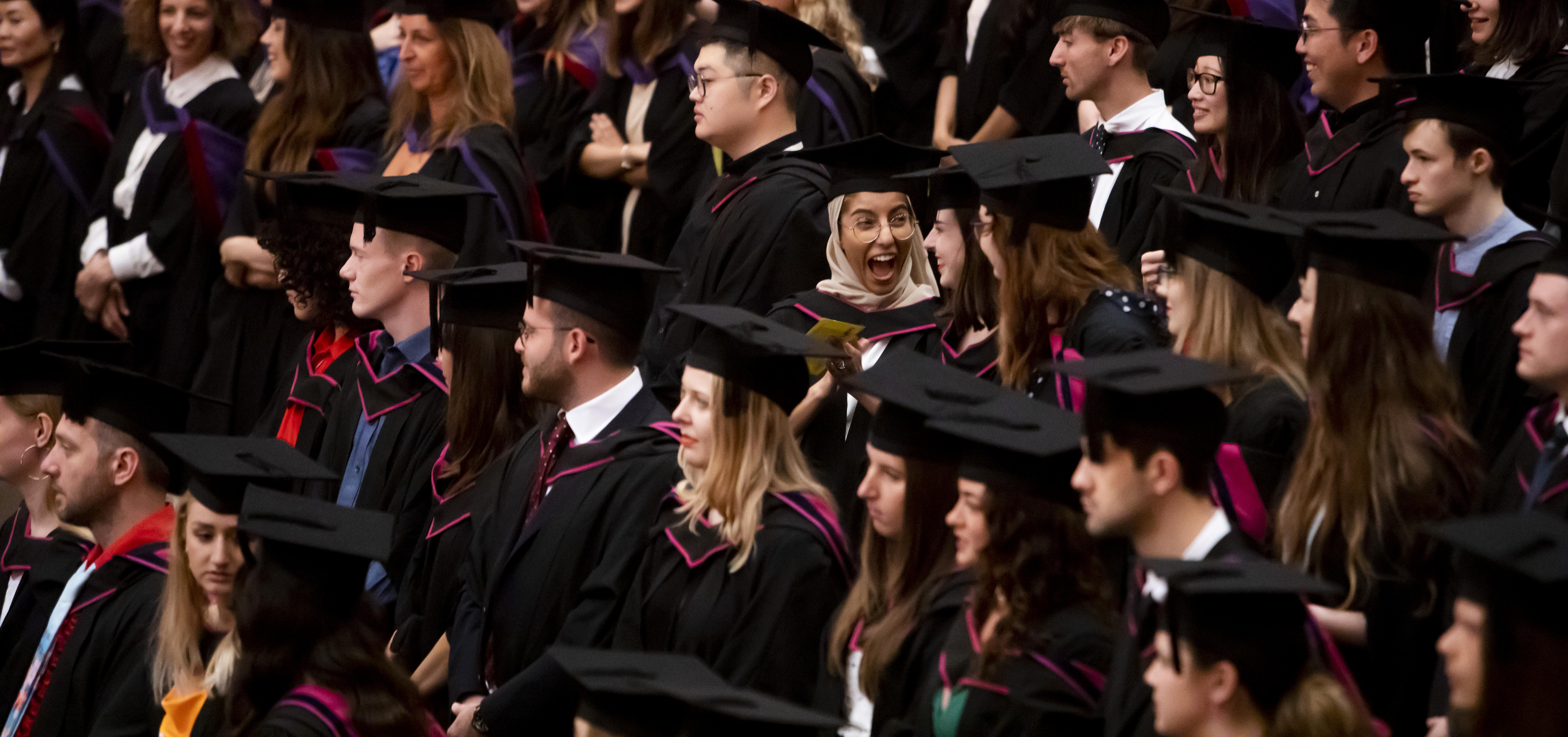 Graduating students sitting in auditorium