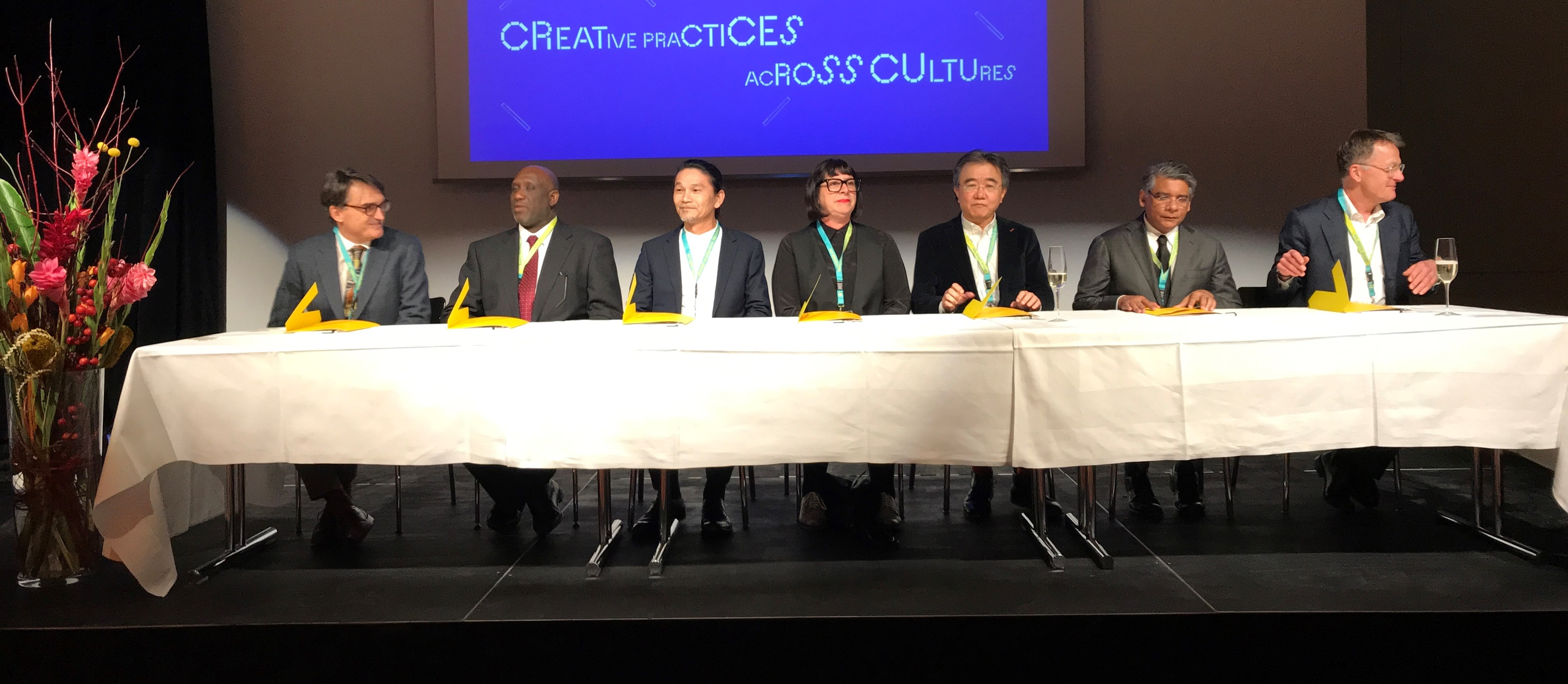 Panel of signatories at a table