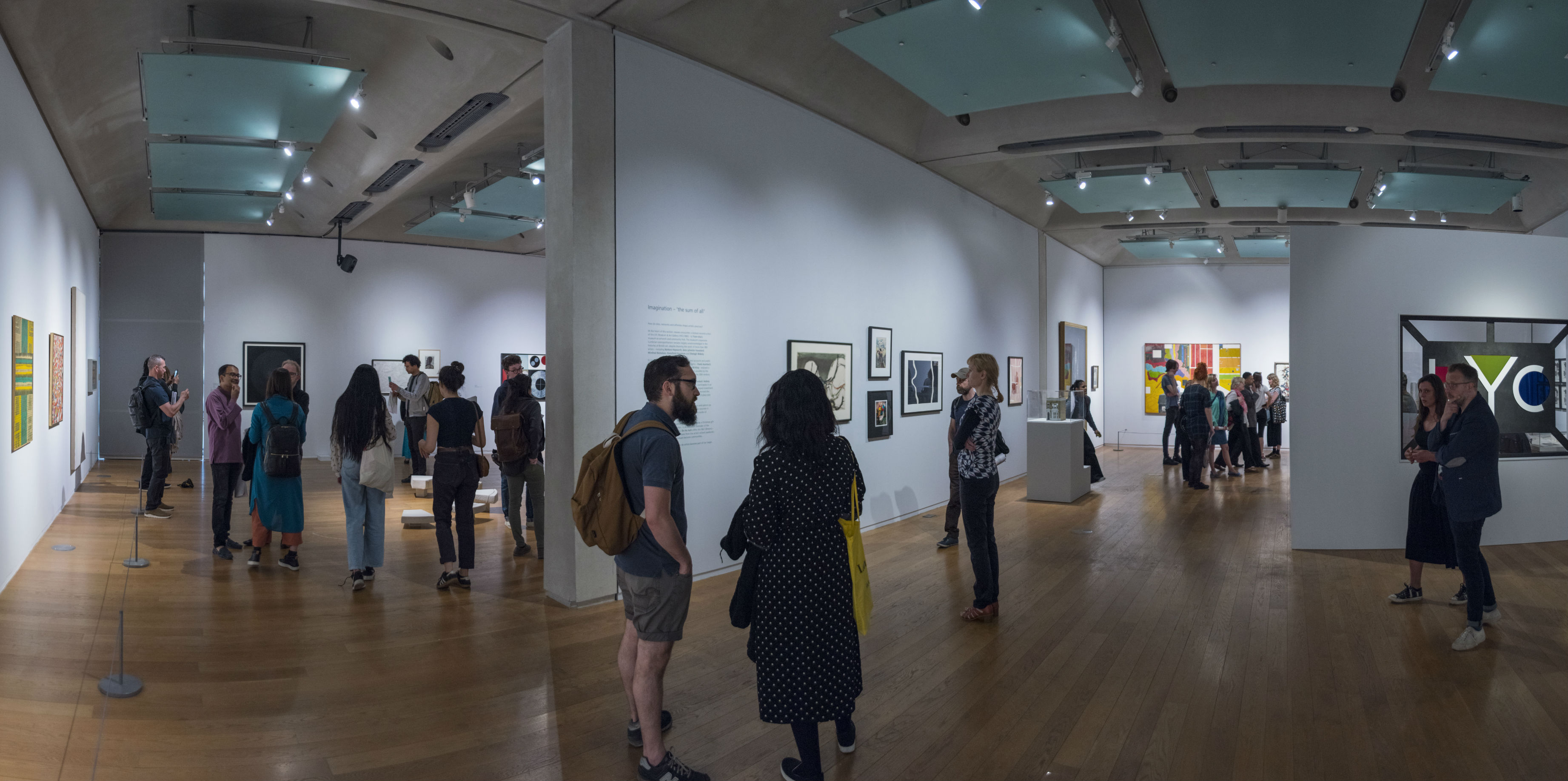 People looking at artworks in an exhibition