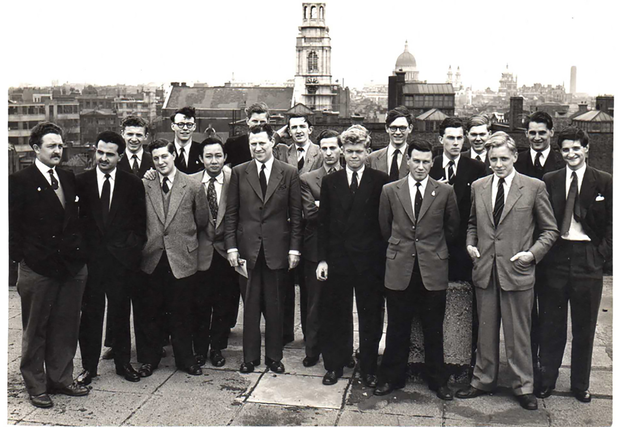 A photograph of the Class of 1956 on a rooftop.